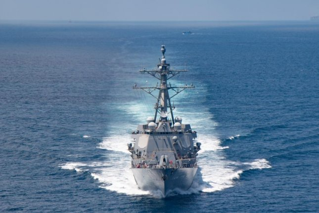 The Arleigh Burke-class guided-missile destroyer USS Kiddmoves through the Taiwan Strait on Friday. Photo courtesy of the U.S. Navy