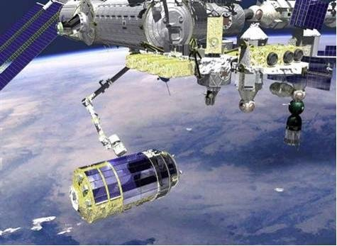 Japanese cargo craft docks with ISS