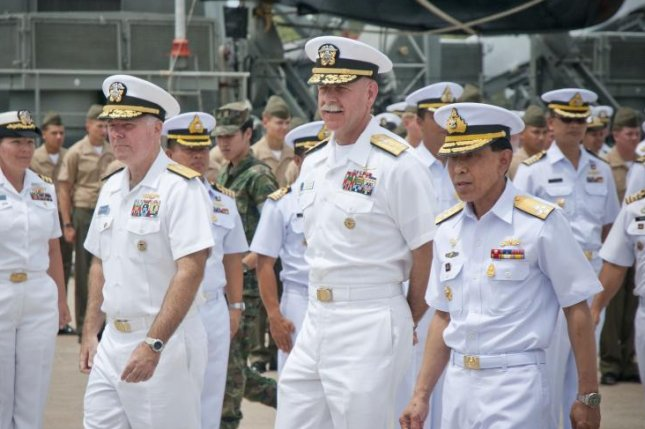 Adm. Scott Swift, center, said Tuesday in Sydney, Australia, that friction points are a threat to maritime freedom and international law in the South China Sea. File Photo courtesy of U.S. Navy