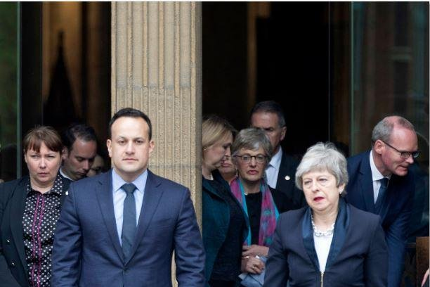Northern Ireland Prime Minister Leo Varadkar (L) and British Prime Minister Theresa May leave Saint Anne's Cathedral in Belfast, Northern Ireland, on Wednesday  after the funeral of journalist Lyra McKee.  Photo by Arthur Carron/EPA-EFE