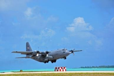 A U.S. Air Force C-130 cargo plane lands at Wake Island Airfield. The isolated military installation in the Pacific Ocean is undergoing $87 million in improvements. Photo courtesy of 15th Wing, 11 AD Deatachment1, Wake Island/U.S. Air Force