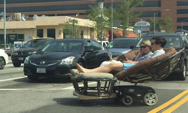 Reddit user socalsubie shared a photo of a couple driving a motorized papasan chair down a Los Angeles street. A user claiming to be the man's cousin revealed some details about his personal life and said he may be willing to provide a tutorial about how the vehicle was built.  Photo by socalsubie/Reddit