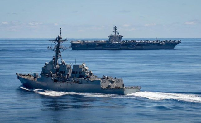The U.S. Navy's Carrier Strike Group 1, which includes the aircraft carrier USS Carl Vinson, background, and destroyer USS Dewey, foreground, arrived in Hawaii this week for training. Photo by MCS3 Olympia McCoy/U.S. Navy