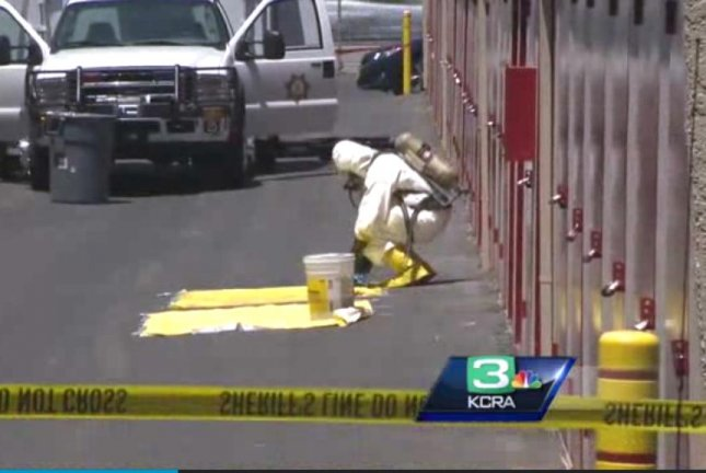 A hazmat crew works to clean up the Rancho Cordova, Calif., storage unit where Steve Bohannon and his uncle, Ken, discovered the meth lab. KRCA-TV screenshot
