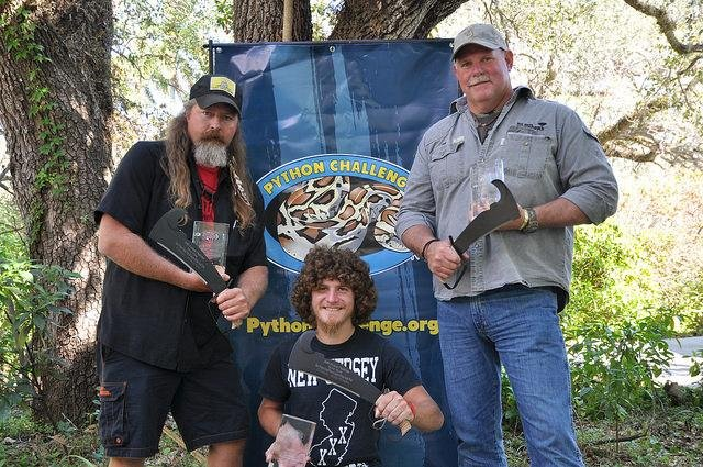 More than 1,000 people from 29 states participated in the Florida Fish and Wild Life Commission's 2016 python challenge. Participants captured 106 snakes including a grand prize winning 15-foot python. Above, members of the grand prize winning team flank individual grand prize winner Daniel Moniz. Photo by Florida Fish and Wildlife Commission/Flickr