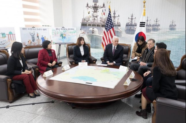 Vice President Mike Pence and second lady Karen Pence -- and Fred Warmbier (R), the father of an American held captive by Pyongyang -- meet with North Korean defectors in South Korea Friday. Photo courtesy Vice President Mike Pence/Twitter
