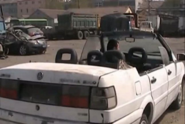 Watch Man Cut Roof Off Scrap Car To Make Convertible