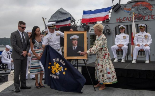 Cindy McCain, R of portrait, wife of the late Navy veteran and Senator John McCain, participated in change of command ceremonies aboard the USS John McCain at Yokohama Naval Base, Japan, on Monday. Photo by MCS1 Torrey W. Lee/U.S. Navy