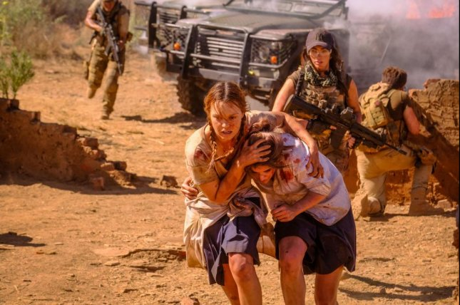 Left to right, Jessica Sutton, Calli Taylor and Megan Fox run in a scene from the action-thriller, Rogue, which is now available on VOD, DVD and Blu-ray. Photo courtesy of Lionsgate