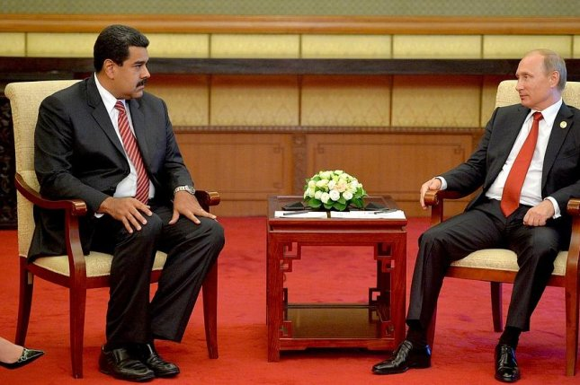 Venezuelan and Russian presidents review depressed oil economies on sidelines of state visit to Beijing. Photo courtesy of the office of Russian President Vladimir Putin.