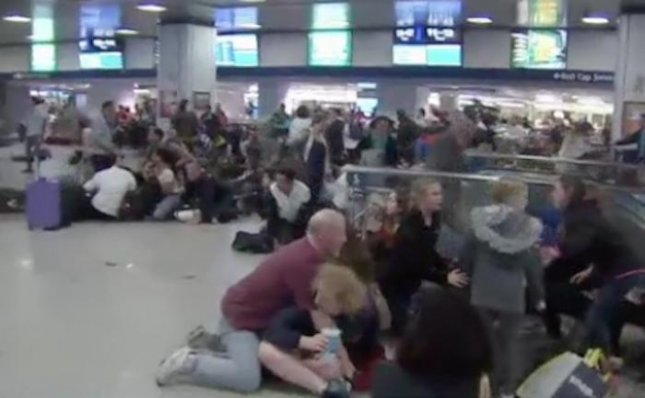 At least 16 people were injured after police used a stun gun on a person in New York's Penn Station and passengers began a panicked stampede believing gunshots had been fired.