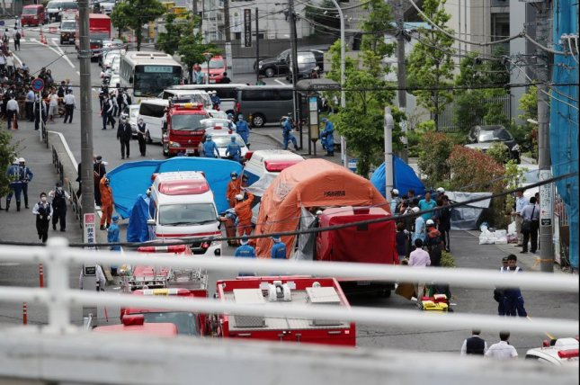 Police and rescue personnel work at the site of a mass stabbing in Kawasaki, near Tokyo on Monday. Photo courtesy of Jiji Press/EPA-EFE