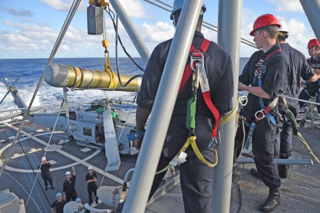 Raytheon has been awarded a $37 million contract for the MK 54 lightweight torpedo, the company announced Monday. Sailors are shown here hoisting one of the torpedoes onto the USS Stockdale in February. U.S. Navy photo
