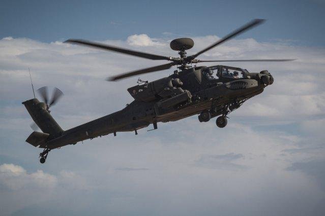 A U.S. Army AH-64E Apache helicopter in flight at Orchard Combat Training Center, Idaho, on September 29, 2016. Photo by Capt. Brian Harris/U.S. Army