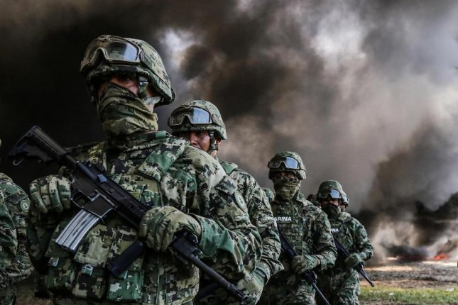 Members of Mexico's Marines participate in the destruction of cocaine, marijuana and psychoactive pills in Acapulco, Guerrero, Mexico, on September 20. File Photo by David Guzmán/EPA-EFE