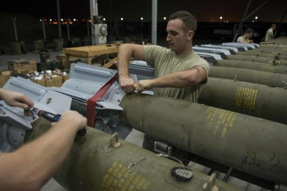 U.S. Airmen assigned to the 447th Expeditionary Aircraft Maintenance Squadron attach fins to GBU-12 Paveway II laser-guided bombs Aug. 8, 2016, at Incirlik Air Base, Turkey. Photo by Senior Airman John Nieves Camacho/U.S. Air Force
