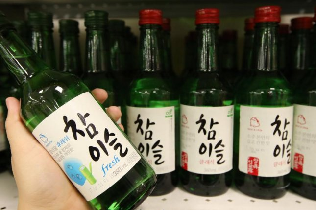 A client looks at a bottle of 'Chamyiseul' Hite Jinro's distilled 'soju' liquor, at an outlet in Seoul, South Korea, on April 18, 2017. Photo by Yonhap/EPA
