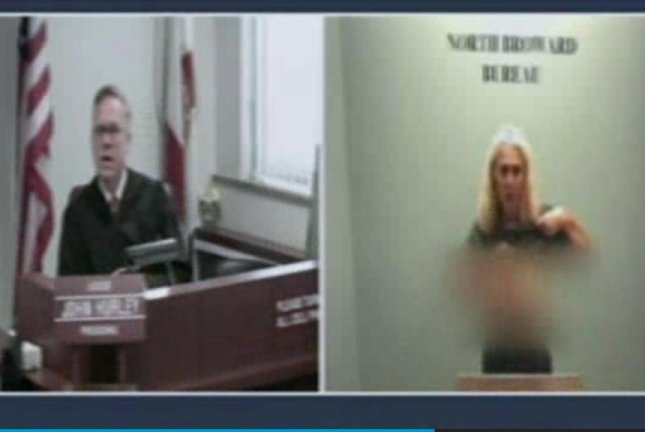 Florida woman flashes breasts to judge in court