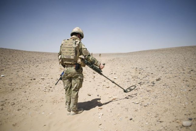 A British soldier learning Counter IED drills. U.K. Ministry of Defense photo by Sgt Ian Forsyth RLC