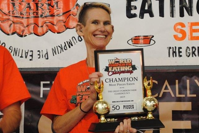 Molly Schuyler broke the record she set two years ago by downing 50 slices of pumpkin pie in 10 minutes in a New York state contest. Photo courtesy of The Great Pumpkin Farm