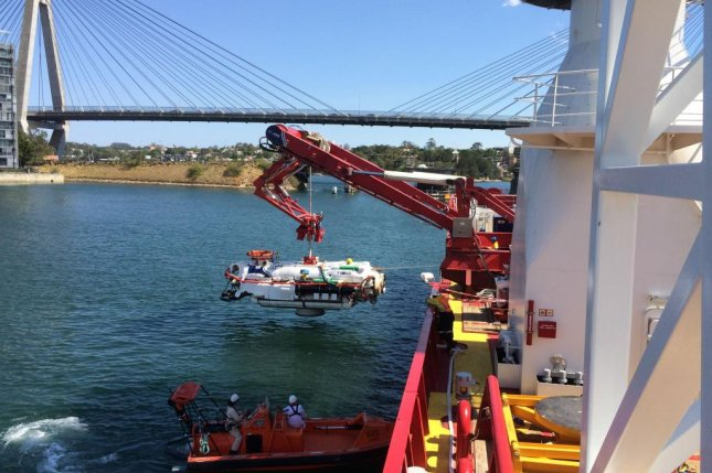 A submarine rescue vehicle from James Fisher Defense is lowered into the water in Australia. Photo courtesy James Fisher Defense