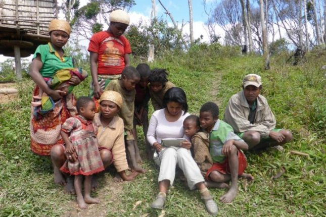 Researcher Rina Mandimbiniaina interviews a local family in eastern Madagascar about how they've been affected by rainforest conservation programs. Photo by S. Rakotonarivo