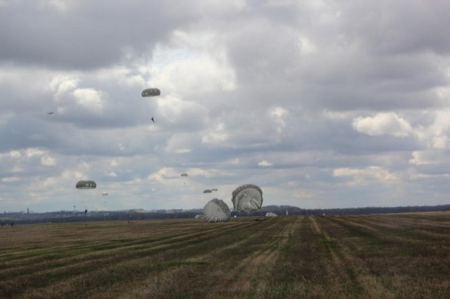 Several Army Reserve paratroopers land on the drop zone at Wright Patterson Air Force Base, Ohio, during day operations in 2016. Photo by David Johnson/U.S. Army
