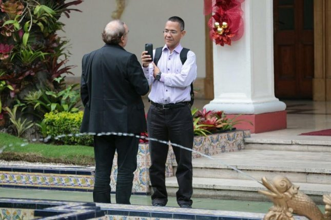 Ernesto Villegas, an official from Venezuela's Communications Ministry seen in this image interviewing a subject in Caracas, has disputed reports saying a crashed helicopter was found with survivors, citing military sources. Villegas said the search for the crashed craft is ongoing. Photo courtesy of Ernesto Villegas