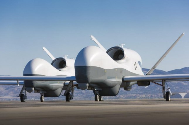 Two Northrop Grumman MQ-4C Triton unmanned aerial vehicles are seen on the tarmac at a Northrop Grumman test facility in Palmdale, Calif. Triton is undergoing flight testing as an unmanned maritime surveillance vehicle. Photo courtesy of Northrop Grumman by Chad Slattery/U.S. Navy