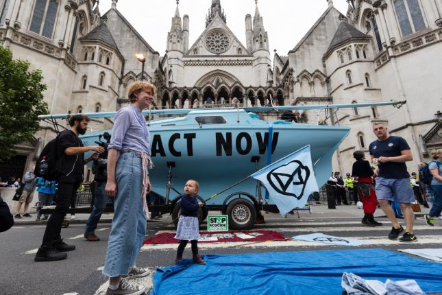 Extinction Rebellion protesters gather Monday around a boat in front of the Royal Court of Justice in London. Photo by Vickie Flores/EPA-EFE