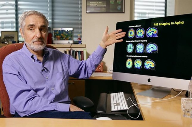 Dr. William Jagust explains how tau and beta amyloid, two proteins associated with Alzheimer's disease, develop in the aging brain, which his research team has visualized using positron emission tomography, or PET, scans. Photo by Stephen McNally/University of California Berkeley