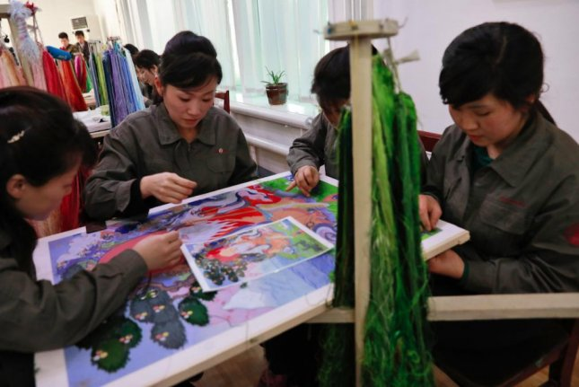 North Korean artists are being commissioned to paint and earn foreign currency for the Kim Jong Un regime, according to a South Korean press report. File Photo by How Hwee Young/EPA