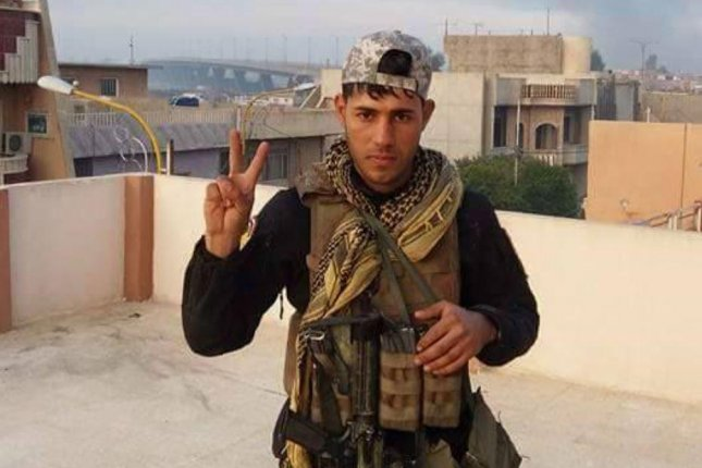 An Iraqi soldier poses for a picture near Mosul's Fourth Bridge, which is seen in the background. The Iraqi Counter Terrorism Service on Sunday said forces are under control of the eastern side of the Fourth Bridge as battle for Mosul against the Islamic State continues. Photo courtesy of Iraqi Counter Terrorism Service