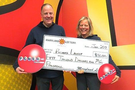A New York state couple said a flt tire while driving through Maryland led them to a $50,000 Powerball jackpot. Photo courtesy of the Maryland Lottery