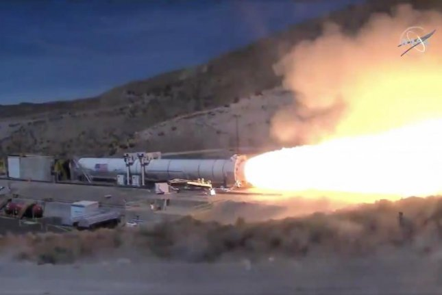 Engineers executed a two-minute test fire of the Space Launch System rocket's full-scale booster on Wednesday afternoon in Utah. Photo by NASA TV/YouTube