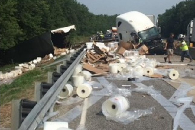 A semi driver attempting to swat a fly inside the vehicle crashed into a concrete barrier and spilled the truck's load of plastic rolls. Photo courtesy of the Indiana State Police