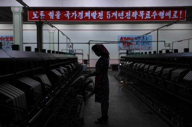 A North Korean woman works at a silk factory in Pyongyang, North Korea, on Sept. 7, 2018. Photo by How Hwee Young/EPA-EFE