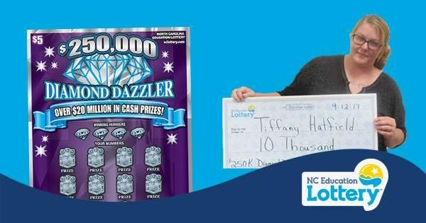 Look: Woman wins $10,000 on lotto ticket bought while fleeing