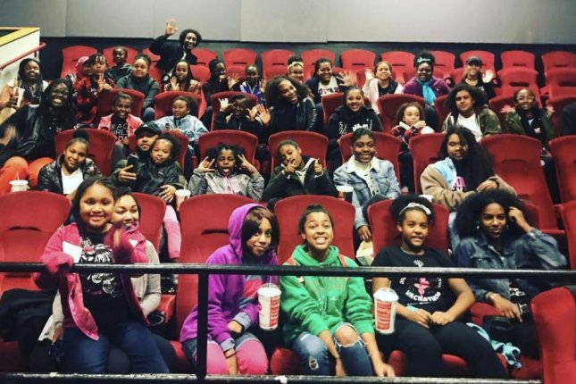 Tennis star Serena Williams sits with girls from Black Girls Code at a private screening of Black Panther Thursday at AMC Van Ness 14 in San Francisco, Calif. Photo courtesy of Alexis Ohanian/Instagram.