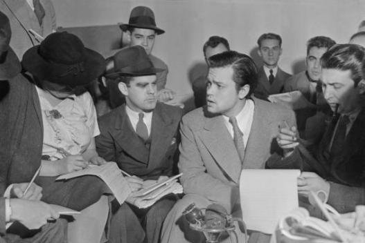 Author Orson Welles meets with reporters on October 31 1938 to explain the radio broadcast of The War of the Worlds was not expected to cause panic. Photo courtesy Acme News Photo/Wikipedia
