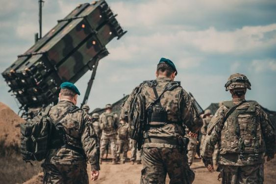 Service members from the U.S. Army and the Polish Land Forces walk to the site of the new Patriot missile system for a verbal demonstration of its operation and capabilities near Drawsko Pomorskie, Poland, on June 4, 2018. Photo by Spc. Aaron Good/Michigan Army National Guard
