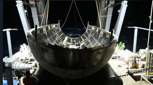 Half of SpaceX's Falcon Heavy nose cone after the April 11 launch is shown aboard a ship in the Atlantic Ocean. Photo courtesy of Elon Musk/SpaceX