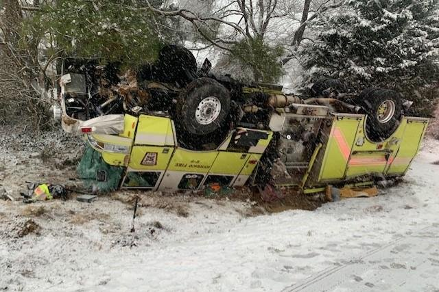Slippery road conditions caused a fire engine with Henrico County in Virgnia to spin and overturn while responding to a service call. The firefighters exited and were taken to hospitals with non-life threatening injuries. Photo courtesy Henrico County Givernment/Twitter