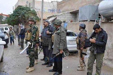 About a dozen Iraqi Kurdish Peshmerga officers arrive in Kobane, Syria, on Oct. 30, 2014. (UPI/Twitter/KRG-USA)