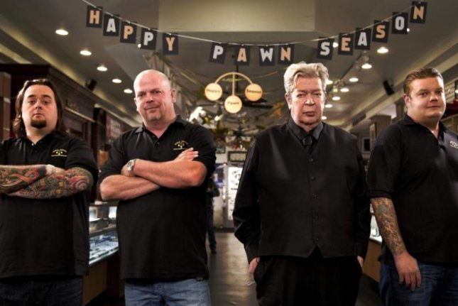 Austin Chumlee Russell with Rick, Rich and Corey Harrison in 'Pawn Stars.' (History)