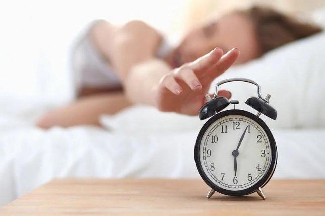 More than 40 percent of Americans said they will spend the extra house when clocks fall back Sunday on sleep. Photo courtesy of HealthDay News