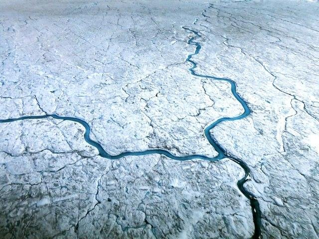 Greenland loses ice to the sea mainly through two processes: the shedding of icebergs from glaciers that run into the sea, and surface melt runoff. Image courtesy of NASA