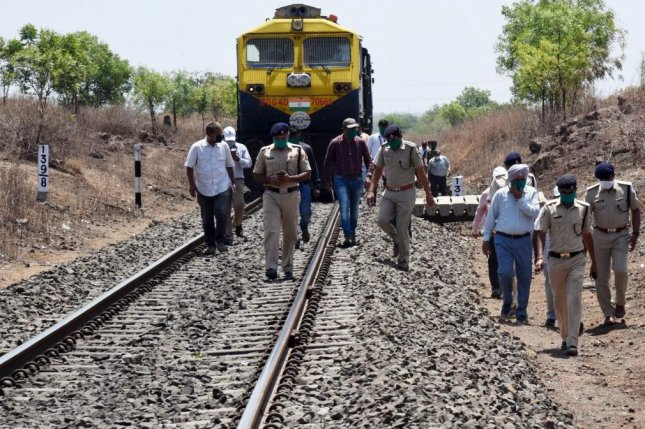 Authorities inspect the location where more than a dozen workers were killed by a train Friday near Aurangabad, India. Photo by EPA-EFE