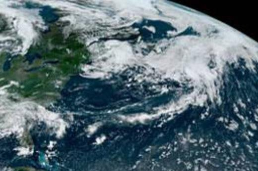 Tropical Storm Edouard is seen Monday about 430 miles southeast of Newfoundland, Canada. It was the earliest fifth named storm since the satellite era of the 1960s and 1970s. Image courtesy of NOAA/NHC