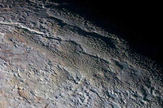 Sublimation on Pluto is forming a unique ice formation only previously found on Earth. Photo by NASA/Johns Hopkins University Applied Physics Laboratory/Southwest Research Institute